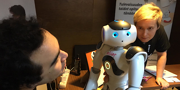 Two people with robot
