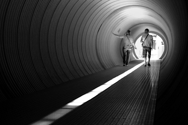 Perspective of two people in tunnel